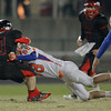 Stuart Fine (40) is tackled as Middle Creek crushes Athens Drive 56 to 21 Friday night October 25, 2013. (photo by Jack Tarr 2013)