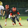 Middle Creek's Stuart Fine (40) runs the ball. Middle Creek rolls over E.E. Smith 56 to 7 Friday night August 30, 2013. (Photo by Jack Tarr)