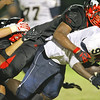 E.E. Smith's runner is tackled by Middle Creek. Middle Creek rolls over E.E. Smith 56 to 7 Friday night August 30, 2013. (Photo by Jack Tarr)