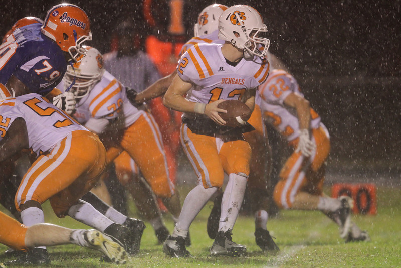 Fuquay's Caleb Mundy (12) is ready to hand off. Fuquay defeats Athens Drive 24 to 13 Friday night November 1, 2013. (Photo by Jack Tarr)