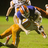 Athens Drive's Nick Harvilla (82) is tackled after a catch. Fuquay defeats Athens Drive 24 to 13 Friday night November 1, 2013. (Photo by Jack Tarr)