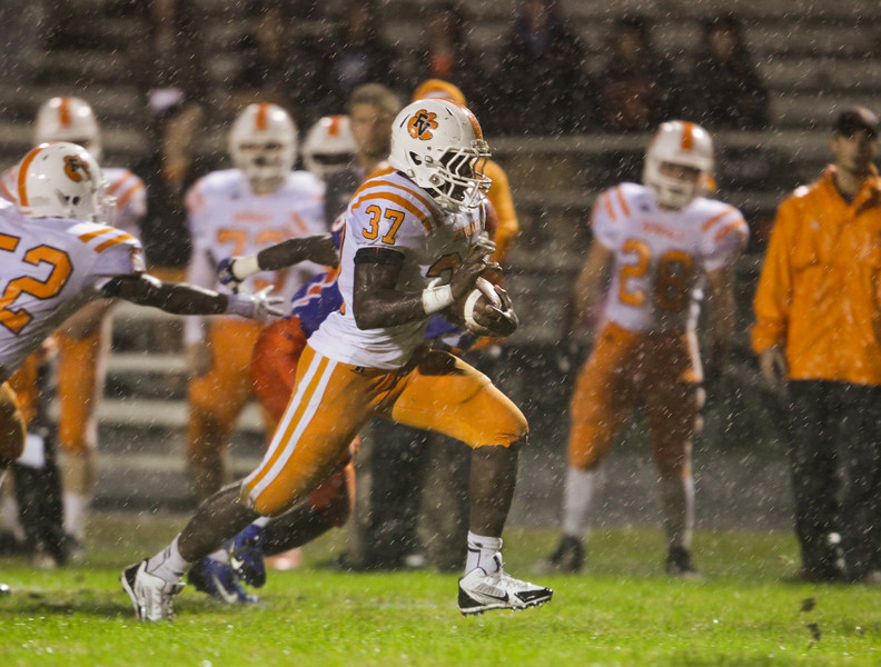 Fuquay's  Damarus Williams(34) runs the ball. Fuquay defeats Athens Drive 24 to 13 Friday night November 1, 2013. (Photo by Jack Tarr)