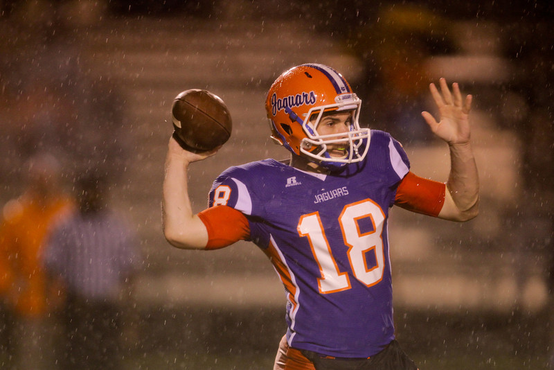 Athens Drive's John Politis (18) passes the ball. Fuquay defeats Athens Drive 24 to 13 Friday night November 1, 2013. (Photo by Jack Tarr)
