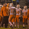 Fuquay's Caleb Mundy (12) speaks with his head coach. Fuquay defeats Athens Drive 24 to 13 Friday night November 1, 2013. (Photo by Jack Tarr)