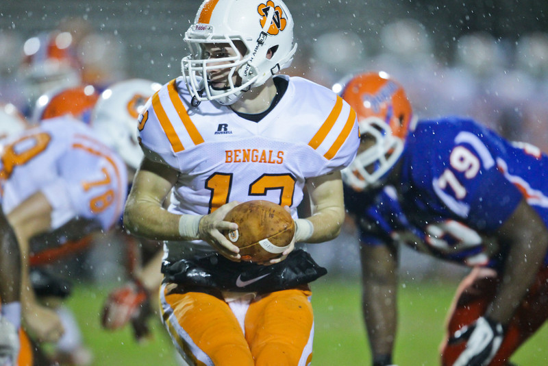 Fuquay's Caleb Mundy (12) hands the ball off. Fuquay defeats Athens Drive 24 to 13 Friday night November 1, 2013. (Photo by Jack Tarr)