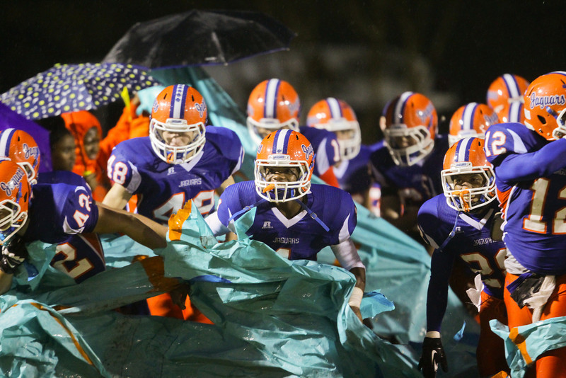 Athens Drive takes the field. Fuquay defeats Athens Drive 24 to 13 Friday night November 1, 2013. (Photo by Jack Tarr)