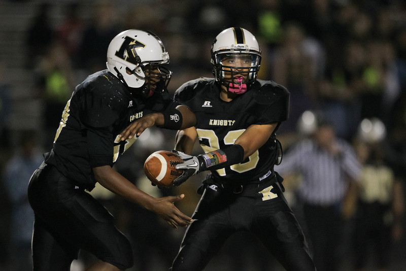 Knightdale's #23 Marquavious Johnson hands the ball off as Knightdale defeats Durham Hillside 16 to 15 Friday night November 22, 2013 in round two of the NCHSAA Football playoffs. (Photo by Jack Tarr)