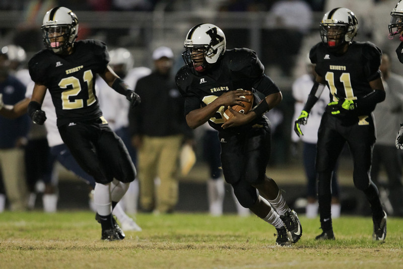 Knightdale's #38 Nate Harvey ruins the ball as Knightdale defeats Durham Hillside 16 to 15 Friday night November 22, 2013 in round two of the NCHSAA Football playoffs. (Photo by Jack Tarr)