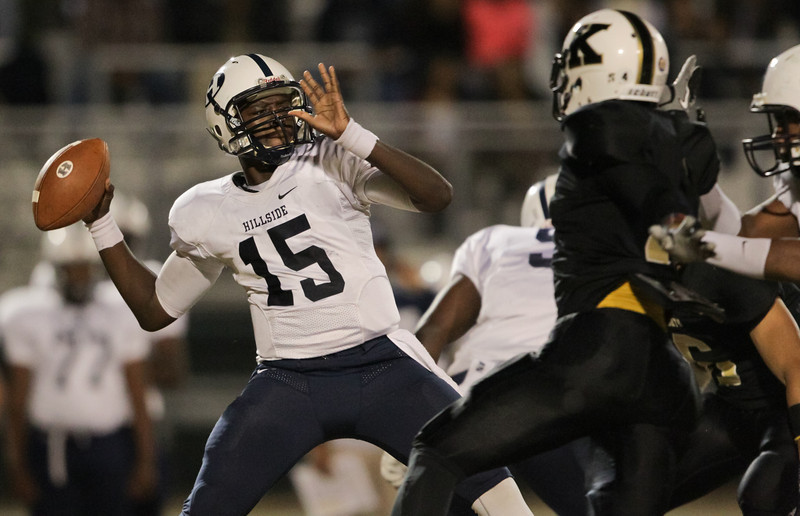 HillsideQB Nas Forte-Ferguson #15 passes the ball. Knightdale defeats Durham Hillside 16 to 15 Friday night November 22, 2013 in round two of the NCHSAA Football playoffs. (Photo by Jack Tarr)