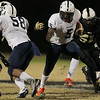 Hillsides #5 Dontae Thomas-Williams runs the ball. Knightdale defeats Durham Hillside 16 to 15 Friday night November 22, 2013 in round two of the NCHSAA Football playoffs. (Photo by Jack Tarr)