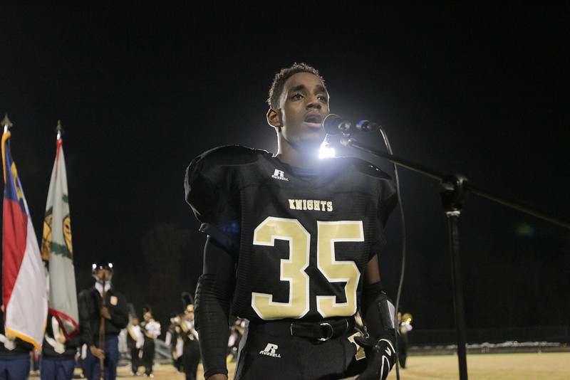 Knightdale's #35 Devin Lasane singing the national anthem. Knightdale defeats Durham Hillside Friday 16 to 15 night November 22, 2013 in round two of the NCHSAA Football playoffs. (Photo by Jack Tarr)