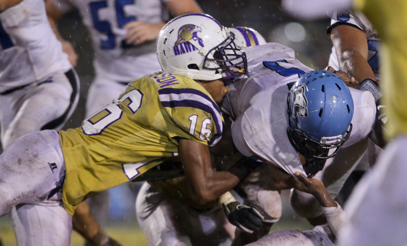 Panther Creek's  Dorrel McClain (5) is tackled. Panther Creek rolls over Holly Springs 27 to 0 Friday night November 1, 2013. (Photo by Jack Tarr)