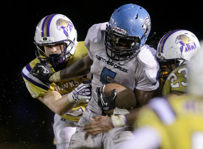 Panther Creek's  Dorrel McClain (5) runs the ball. Panther Creek rolls over Holly Springs 27 to 0 Friday night November 1, 2013. (Photo by Jack Tarr)