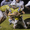 Holly Springs Will Forrestal (18) is tackled for a short gain. Panther Creek rolls over Holly Springs 27 to 0 Friday night November 1, 2013. (Photo by Jack Tarr)