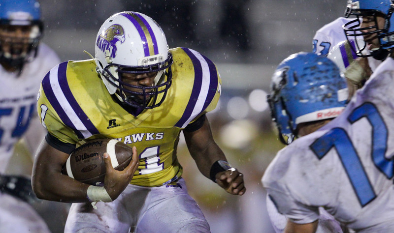 Holly Springs D.j. Cornish (11) runs the ball. Panther Creek rolls over Holly Springs 27 to 0 Friday night November 1, 2013. (Photo by Jack Tarr)