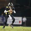Apex's Grayson Boyd (10) drops back to pass. Riverside drifts by Apex 37 to 3 Friday September 20, 2013(photo by Jack Tarr 2013)