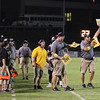 Apex coaches signal in the paly. Riverside drifts by Apex 37 to 3 Friday September 20, 2013(photo by Jack Tarr 2013)