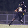 Apex's Grayson Boyd Ian (15) runs the ball. Riverside drifts by Apex 37 to 3 Friday September 20, 2013(photo by Jack Tarr 2013)