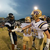 Captains take the field. Millbrook shuts out Broughton 28 to 0 Friday night October 10, 2014. (Photo by Jack Tarr/WRAL Contributor)
