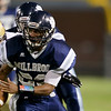Millbrooks #23 Trey Threatt runs the ball. Millbrook shuts out Broughton 28 to 0 Friday night October 10, 2014. (Photo by Jack Tarr/WRAL Contributor)