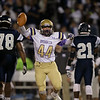 Broughton's #44 Justin Strickland recovers a fumble Millbrook shuts out Broughton 28 to 0 Friday night October 10, 2014. (Photo by Jack Tarr/WRAL Contributor)