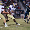 Broughton's #23 Devone Jackson runs the ball. Millbrook shuts out Broughton 28 to 0 Friday night October 10, 2014. (Photo by Jack Tarr/WRAL Contributor)