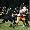 Fuquay's #37 Damarus Williams runs the ball as Apex defeats Fuquay Varina 45 to 35 Friday night October 3, 2014. (Photo by Jack Tarr/WRAL Contributor)