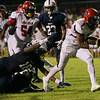 New Bern's #1 Mike Hughes breaks a tackle and goes in for a score as New Bern defeats Durham Hillside 12 to 0  at Durham Hillside High School Friday August 22, 2014. (Photo by Jack Tarr/WRAL contributor.)