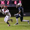 New Bern's #7 Rasheed McCoy makes an interception as New Bern defeats Durham Hillside 12 to 0  at Durham Hillside High School Friday August 22, 2014. (Photo by Jack Tarr/WRAL contributor.)