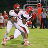 New Bern's #1 Mike Hughes hands the ball off as New Bern defeats Durham Hillside 12 to 0  at Durham Hillside High School Friday August 22, 2014. (Photo by Jack Tarr/WRAL contributor.)