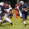 Durham Hillside's #5 runs the ball as New Bern defeats Durham Hillside 12 to 0  at Durham Hillside High School Friday August 22, 2014. (Photo by Jack Tarr/WRAL contributor.)