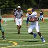 East Wake #3 Tripp Harrington runs the ball during the HighSchoolOT.com Jamboree at Cardinal Gibbons High School Saturday August 16, 2014. (Photo by Jack Tarr/WRAL contributor.)