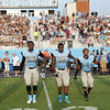 Panther Creek captains take the field. Wake Forest rolls over Panther Creek 23 to 6 Friday August 22, 2014. (Photo by Jack Tarr/WRAL contributor.)