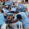 Panther Creek's #2 takes the hand off from #11 Brenden Magner. Wake Forest rolls over Panther Creek 23 to 6 Friday August 22, 2014. (Photo by Jack Tarr/WRAL contributor.)