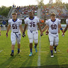 Wake Forest captains take the field. Wake Forest rolls over Panther Creek 23 to 6 Friday August 22, 2014. (Photo by Jack Tarr/WRAL contributor.)