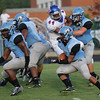 Panther Creek's #4 Juwan Byrd runs the ball. Wake Forest rolls over Panther Creek 23 to 6 Friday August 22, 2014. (Photo by Jack Tarr/WRAL contributor.)