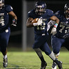 Millbrooks #19 Donavan Darity runs the ball as Millbrook gets by East Wake 34 to 32  Friday August 20, 2015. (WRAL contributor Jack Tarr)