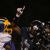 Millbrooks #34 Larry Rountree celebrates after scoring a touchdown as Millbrook gets by East Wake 34 to 32  Friday August 20, 2015. (WRAL contributor Jack Tarr)