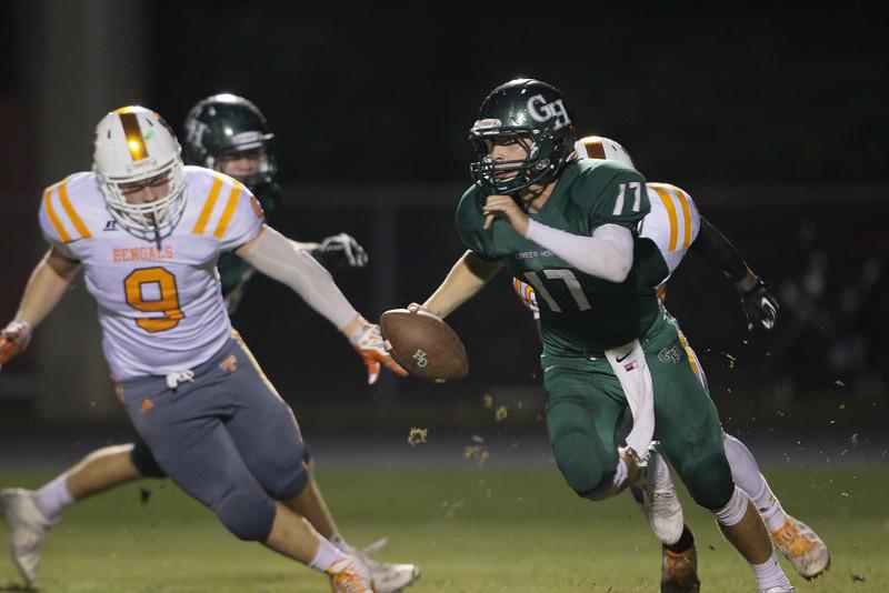 Tucker  Burkinshaw (17) of Green Hope High School scrambles. Fuquay Varina defeats Green Hope 36 to 26 Monday night September 28, 2015. (Photo by Jack Tarr/HighschoolOT.com contributor.)