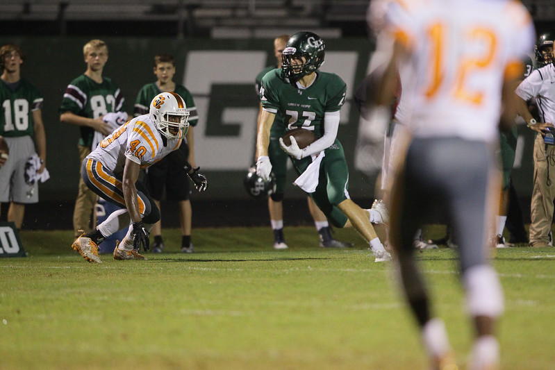 Conner  Redick (22) of Green Hope High School runs after making a catch. Fuquay Varina defeats Green Hope 36 to 26 Monday night September 28, 2015. (Photo by Jack Tarr/HighschoolOT.com contributor.)