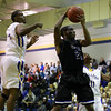 Clayton's #23 Tre Armstead grabs a rebound during the game Wednesday January 23, 2013. (Photo by Jack Tarr)
