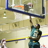 Pine Forest's #25 Isiah Daniel lays one in during the first round of NCHSAA State Basketball tournament game Monday February 25, 2013 (Photo by Jack Tarr)