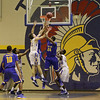A battle under the boards. Garner Rolls over East Wake Apex 84 to 53 Friday night January 24, 2013.(Photo by WRAL Contributor Jack Tarr)