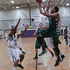 Green Hope Jonathan Clark (15) drives to the hoop as Green Hope defeats Holly Springs 66 to 61 Friday night January 10, 2014 at Holly Springs High School.(Photo by WRAL Contributor Jack Tarr)