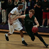 Green Hope Jack Costigan (0) drives to the hoop as Green Hope defeats Holly Springs 66 to 61 Friday night January 10, 2014 at Holly Springs High School.(Photo by WRAL Contributor Jack Tarr)