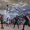 Holly Springs #11 McDaniel takes a shot as Green Hope defeats Holly Springs 66 to 61 Friday night January 10, 2014 at Holly Springs High School.(Photo by WRAL Contributor Jack Tarr)