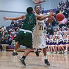 Green Hope's #11 Quavis Johnson defending as Green Hope defeats Holly Springs 66 to 61 Friday night January 10, 2014 at Holly Springs High School.(Photo by WRAL Contributor Jack Tarr)