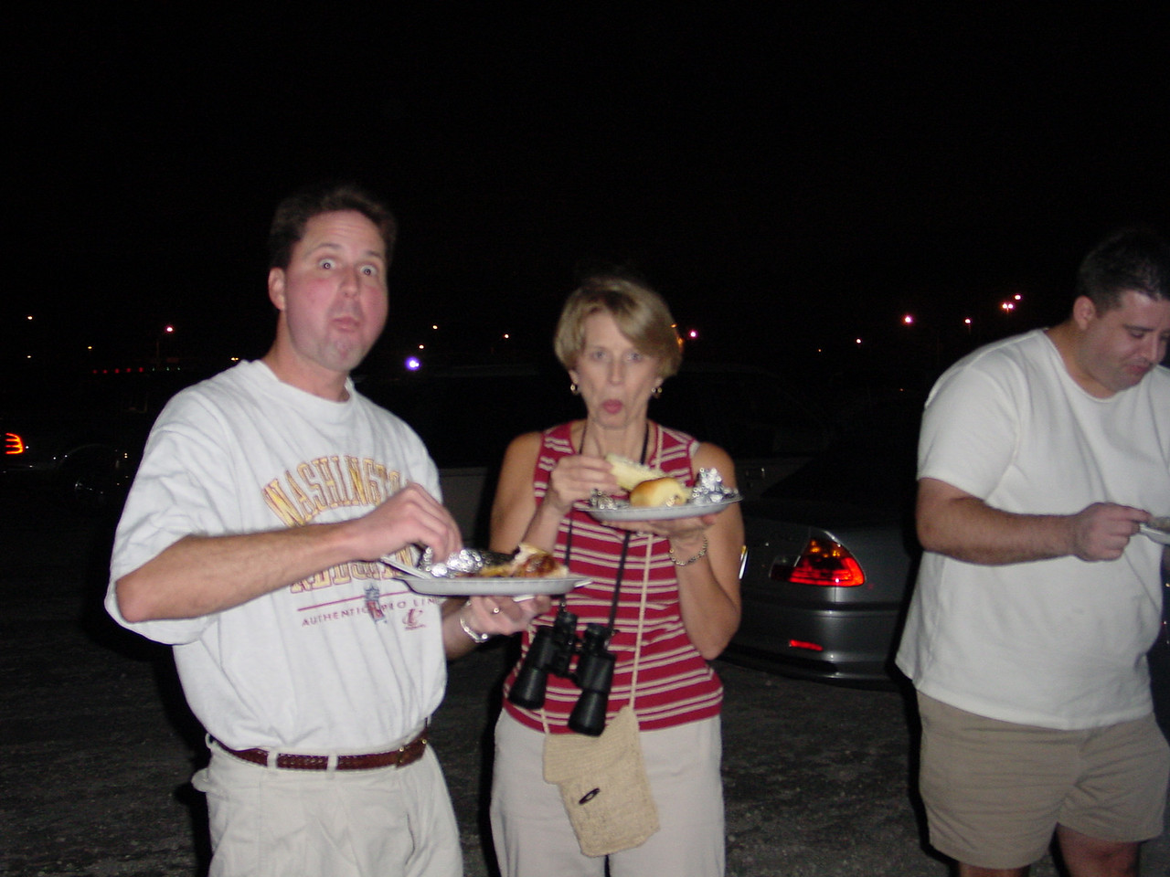 Paul D., Dave's mom (Linda), and dave chowing on Paul D.s cooking