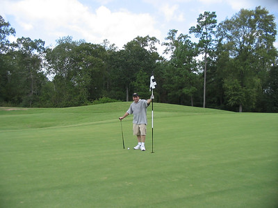 Harry standing by his amazing 2nd shot on a par 5.  You guys buying that BS???
