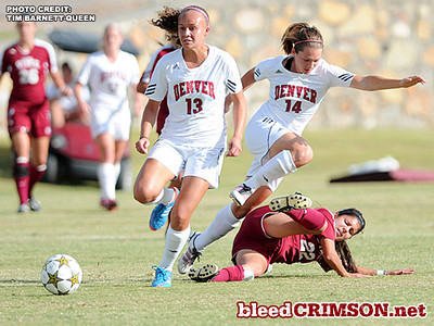 Lauren Cope (22) makes a slide tackle